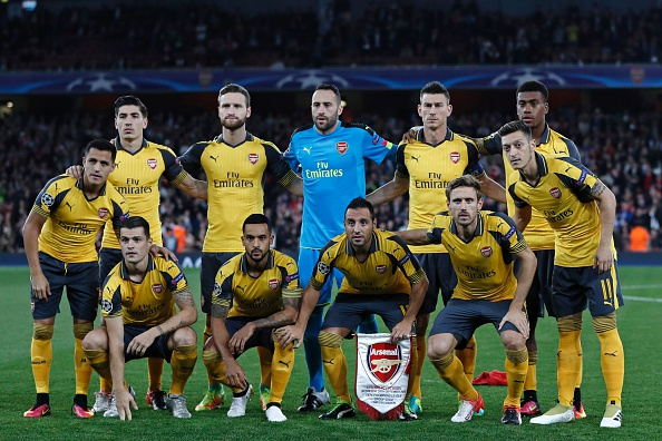 Arsenal team (L-R back row), Arsenal's Spanish defender Hector Bellerin, Arsenal's German defender Shkodran Mustafi, Arsenal's Colombian goalkeeper David Ospina, Arsenal's French defender Laurent Koscielny and Arsenal's Nigerian striker Alex Iwobi, (L-R front row) Arsenal's Chilean striker Alexis Sanchez, Arsenal's Swiss midfielder Granit Xhaka, Arsenal's English midfielder Theo Walcott, Arsenal's Spanish midfielder Santi Cazorla, Arsenal's Spanish defender Nacho Monreal and Arsenal's German midfielder Mesut Ozil line up ahead of the UEFA Champions League Group A football match between Arsenal and FC Basel at The Emirates Stadium in London on September 28, 2016. / AFP / Adrian DENNIS        (Photo credit should read ADRIAN DENNIS/AFP/Getty Images)
